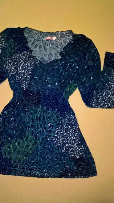 Ženska odeća   Svrljig: Tanka likra. Tunika je dosta fleksibilna,najbolje odgovara M