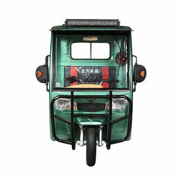 Электрический мотороллер с кабиной.Один заряд хватает на 70--80 км.при