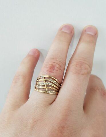 Кольцо в желтом золоте с цирконами. Размер 18,5. Россия. Проба 585