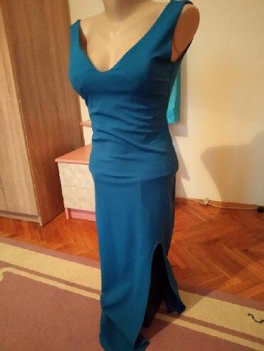 Sexy plava haljinica. Sa push-up dekolteom I v rezom da leve strane - Belgrade