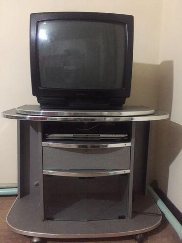 Продаю телевизор с подставкой и ДВД все отлично работает показывает цв