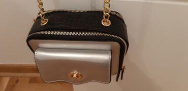 Nenosena torba, dobijena na poklon. Kombinacija crne, zlatne i