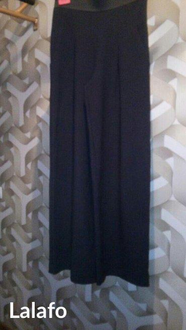 юбки из плотного трикотажа в Кыргызстан: Юбка с запахом, черн трикотаж, разм 40, длина макси, пооизв Турция