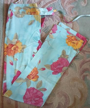 Pantalone zute - Srbija: Marcello - Lagane letnje pantalone, moderne, cvetni dezen. Kao nove su