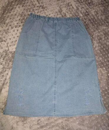 Teksas suknja XL. Ima dva dzepa. Duzina 70cm. Sa lastisem u struku