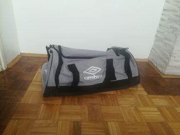Torba visina duzina - Srbija: Nova torba, malo je prasnjava od stajanja, duzina 66cm,sirina 34 cm