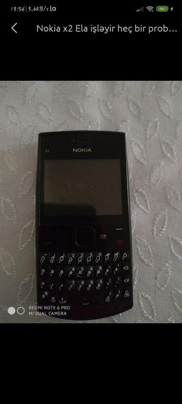 canon kiss x2 в Азербайджан: Nokia X2-01 her birseyi işləkdir ekran dəyişilməlidir sadəcə
