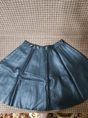 Продаеться юбка Zara кожанная б/у,цвет чёрный,размер S, в хорошем