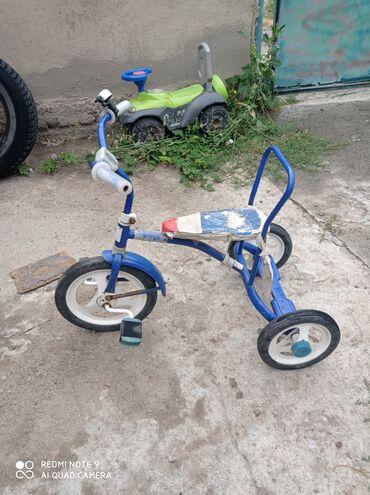 Детский мир - Шевченко: Продаю детский велосипед в хорошем состоянии и машинку толокар за оба