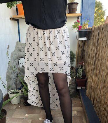 H&M asimetricna suknja. Oznacena velicina 40. U struku ima lastis