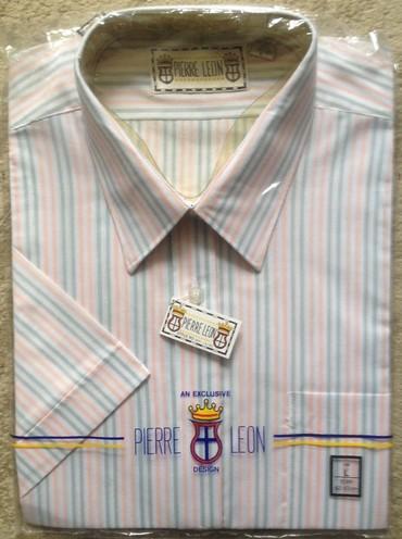 Продаю новую рубашку,короткий рукав, размер по вороту 42, состав 65 %