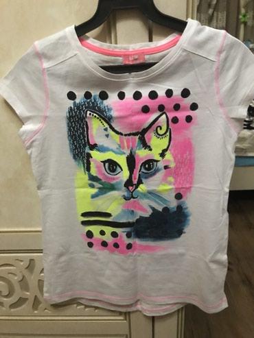 женскую футболку в Кыргызстан: Продаю красивую футболку,новая