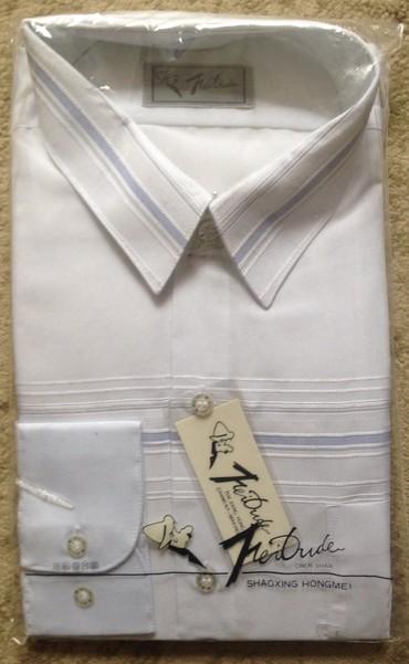 Продаю новую рубашки, размер по вороту 43, состав 65 % полиэстер + 35