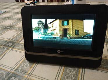 Lcd televizor - Srbija: Mpman portabl DVD 7incha baterija drzi dugo,DVD citac radi,USB