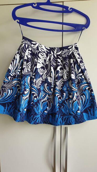 Модная юбка с карманами и ярким принтом от Kira Plastinina