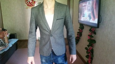 Пиджак школьный. на мальчика. (примерно на 13-15лет.) сост. Отличное