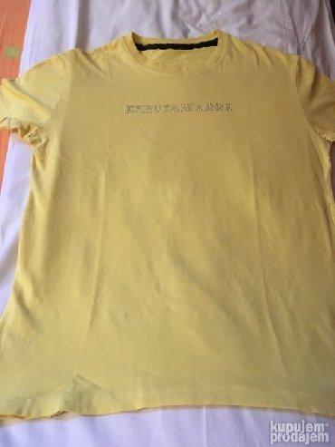 Men's T-shirts - Srbija: Original majca De Puta Madre žute boje sa cirkonima. Dužina majce