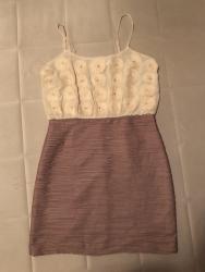 Divna kratka haljina, u odlicnom stanju. Velicina je L, ali odgovara - Crvenka