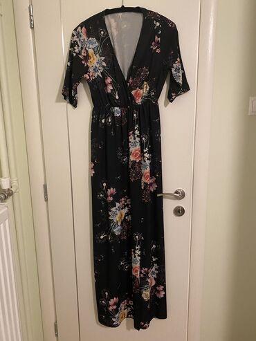 Φόρεμα μαύρο με άνοιγμα. S/M