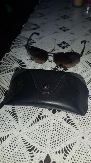Personalni proizvodi - Srbija: U pitanju su skoro nekorišćenje muške original Ray Ban naočare za sunc