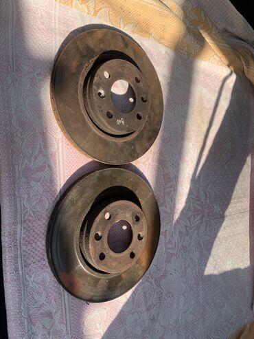 Автозапчасти - Каинды: Ниссан Микра! Тормозные диски. Стояли на Ниссан Микра 1.3 2008 год