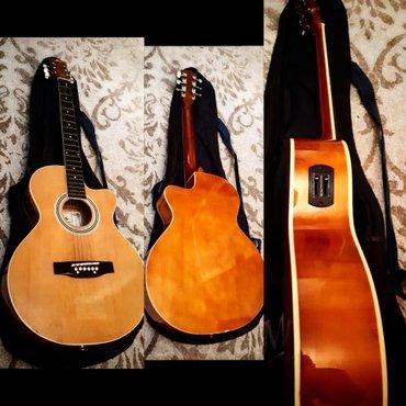Bakı şəhərində Z-power firmasinin 2ci el amma teze kimi elektro akustik gitarasi qali