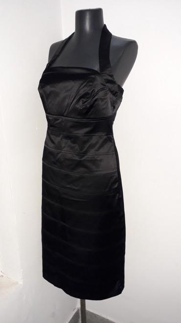 Nasello Savrsena,crna haljina,midi,uz telo,deo kod grudi je postavljen - Pancevo