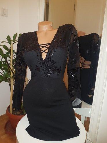 Elegantna haljina. Haljina ima postavljene korpice u predelu grudi - Belgrade