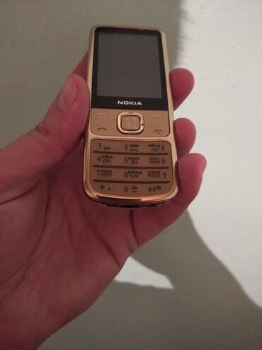 nokia-slide в Азербайджан: Nokia 6700 modeli telefon tam orijinal telefondur üzerinde her hansı