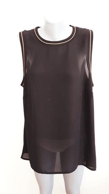 Bluza Woman 44/46 cena 700 poliester sirina grudi 62 duzina ledja 76