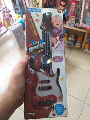 qitara - Azərbaycan: Qitara,daha boyuk razmerlerde Gitaralarimzda var.her nov oyuncaqlarin