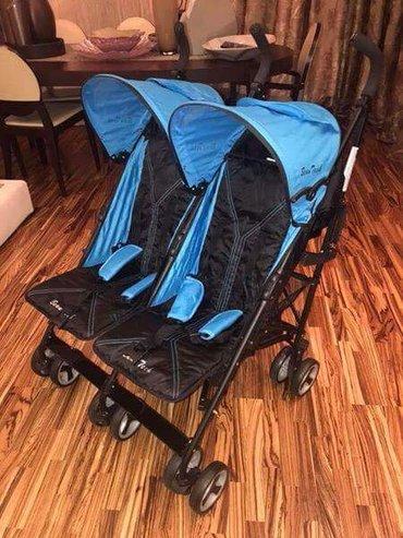 Bakı şəhərində Продаётся коляска трость для двойняшек, новая, привозная, очень удобна
