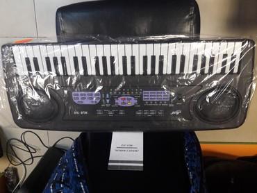 Sintizator miles firmasi 4 oktava yarim mikrafonlu piano dersine