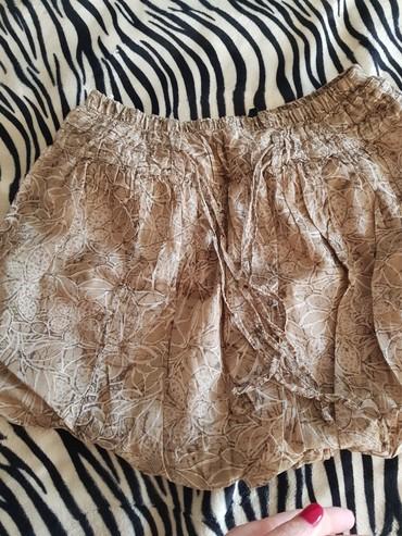 Suknjica beneton,par puta obučena,pufnasta,veličina S,M - Novi Banovci