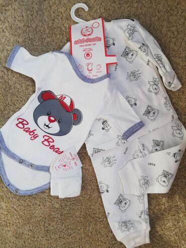 Новый костюм для новорожденных. В комплекте имеются распошонка