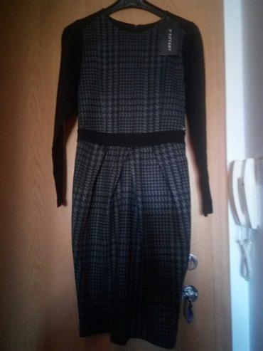 Haljine - Cacak: Potpuno nova,nenošena haljina marke Tiffany.Veličina XL