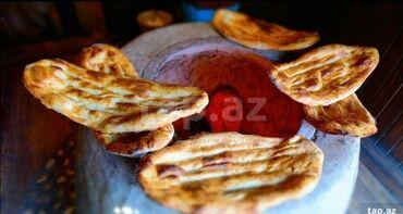 chopard saat - Azərbaycan: Təndirxanaya təndir çörəyi bişirən məsuliyətli işinin peşakarı olan