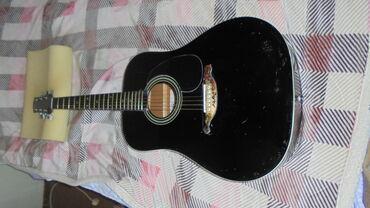Prodajem jednu odličnu veliku western gitaru dužina 105 cm na gitari