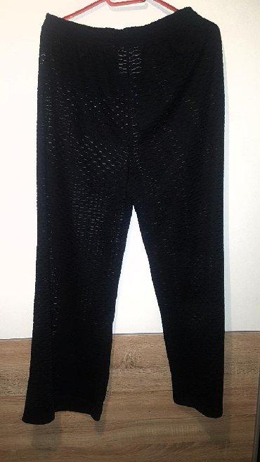 Bele-siroke-pantalone - Srbija: Pantalone prelepe providne zvonaste siroke L-XL velicina iako pise M
