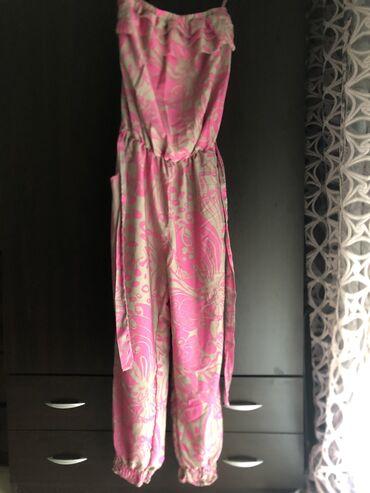 Ολόσωμη φόρμα,αρίστης κατάστασης,φορεμένο 1 φορά,σε μέγεθος small αλλά