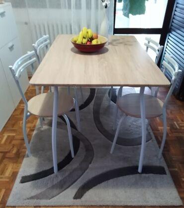 Trpezarijski sto i 4 stolice-emmezetaCena 10000 din. Dim. 120x80x75cm