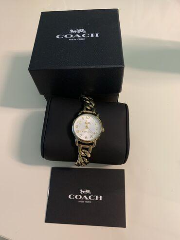 - Azərbaycan: Coach saat.Xaricden alınıb.Yenidir kitabıda var.Gold plateddir.Yeni