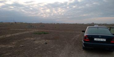 Gəncə şəhərində AFTAZAVOD Qesebesinde cuce zavodunun sag terefinde 4 sot torpaq sahesi