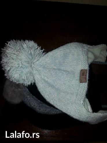 Ženska odeća | Crvenka: Akcija-prodaje se kesa zimskih kapa sa buckama nove iz italije sve za