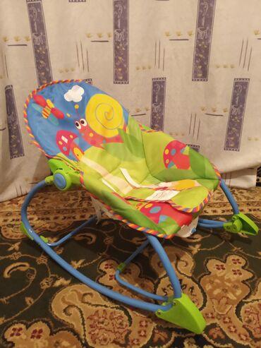 Кресло качалка, с вибро сиденьем почти новая, не пользовались
