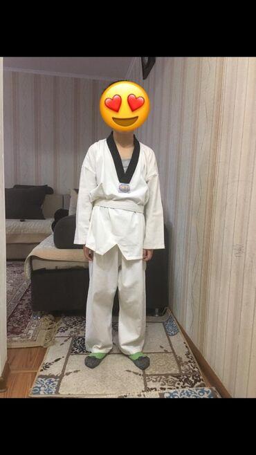 Продаю б/у кимоно для тайквондо на 7-12 лет. ( ткань ХБ)