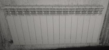 15 seksiyali 1.5 metr radiator yaxsi veziyetdedi genis qonag otaglari