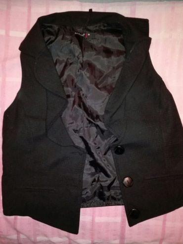 Elegantan prsluk crne boje marke Kiwi broj 38 - Odzaci
