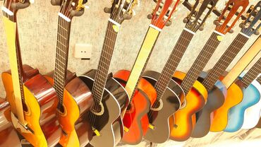Gitara klassik pesekar muellim yanina getmek ucun keyfiyyetli  RAST Mu