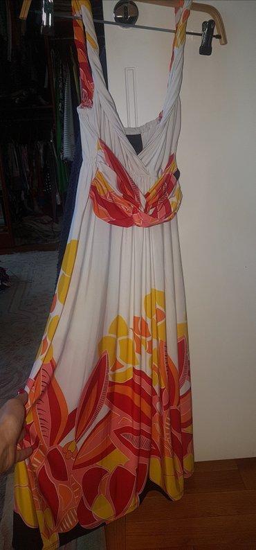 Stoji lepo - Srbija: Slatka bela haljina sa cvetnim detaljima. Prijatna za leto. Lepo